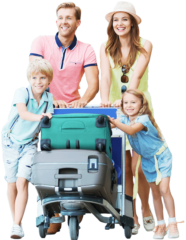 A family laughingly pushes a baggage car with two large suitcases on it. The father, the mother, a boy and a girl are all dressed in summer clothes.